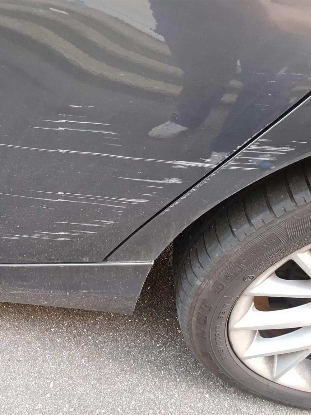 Bodywork scratches and vandal damage before